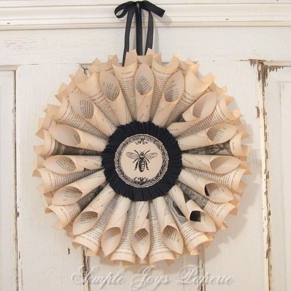 Gorgeous Vintage Book Wreath love the black crepe paper and bee! This was made by SimpleJoysPaperie $50.00. Love Love it!