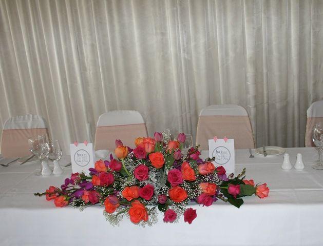 Vibrant long and low wedding arrangement