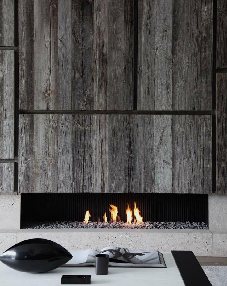 pinned by barefootstyling.com Heavy wood panneling + sleek metal fireplace (by Glenn Sestig)
