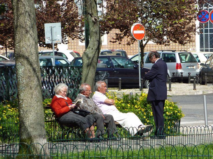retired folks enjoying Spring sun in Lisbon