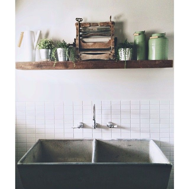 My laundry  Original concrete trough from old house, recycled timber mantle and we found this old clothes wringer that was left behind in the old house #100yearsold #houserelocation #countrystyle #laundry #interiordesign #concrete #weatherboard #mycountryhome