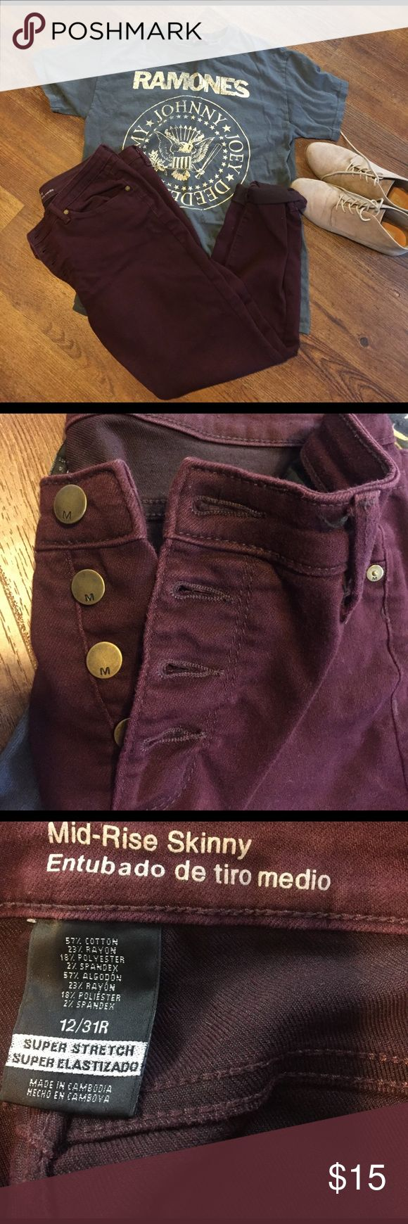 Maroon skinny jeans Maroon mid-rise skinny jeans with button fly. Slight pilling in the crotch area but it's very high up and not noticeable. Size 12/31R Mossimo Supply Co. Jeans Skinny
