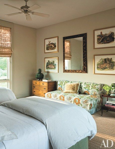 Reproduction Audubon prints hang in a guest room; the banquette is clad in needlework.