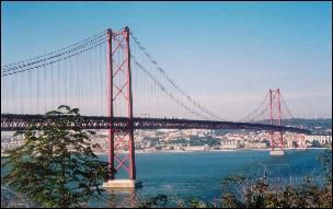 25 de Abril Bridge across the Tagus River in Lisbon, Portugal;  originally named after dictator Salazar, its name was changed after a revolution on April 25, 1974;  completed in 1966;  has an overall length of 1.5 miles, and its longest central span is 3323 feet (longer than the Golden Gate Bridge in San Francisco, CA, and the longest in Europe)
