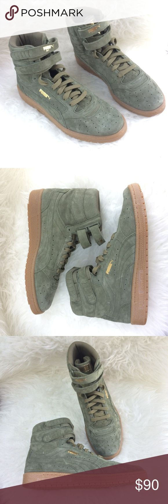 ⚡️PUMA Sky II Hi - Women's Burnt Olive/Gold⚡️ Size: 8 & 9 . Brand new, without box. Get these now!! First introduced in 1980 and played on the court by all-stars, the Sky II Hi was PUMA's original basketball shoe. This re-issue brings the OG silhouette to life in all-over nubuck. -Nubuck upper -Lace closure for a snug fit -Dual hook-and-loop straps for a signature look -Rubber outsole for grip -PUMA Formstrip at both sides -PUMA Logo Label at tongue -PUMA Cat Logo at heel Puma Shoes Sneakers