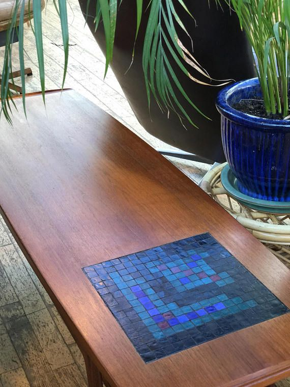 Super-sleek Danish surfboard coffee table with inset mosaic