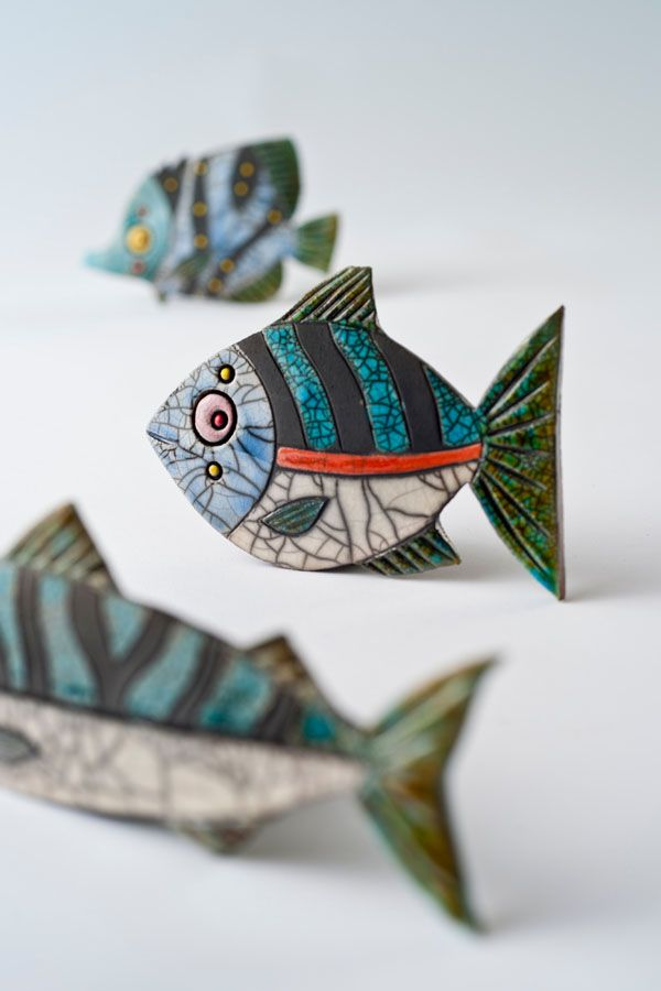 Julian Smith Ceramics. Is it me or is that fish watching us. Really beautiful accent art.