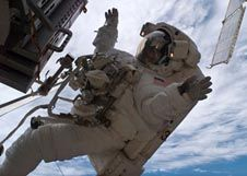 Astronaut Sunita Williams waves as she is working outside the space station
