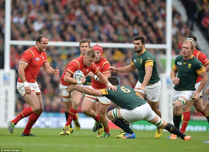 Full-back Gareth Anscombe takes the contact in the early stages of Wales' quarter-final match with South Africa on Saturday