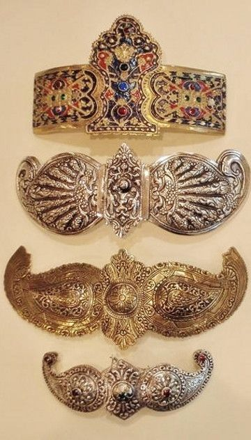 Women's belt buckles from Ioannina (northern Greece), late-Ottoman era, 19th century. Made of various materials: silver, gilt silver, silvery metal (alpaca or other compositions). Called: 'pafti'.