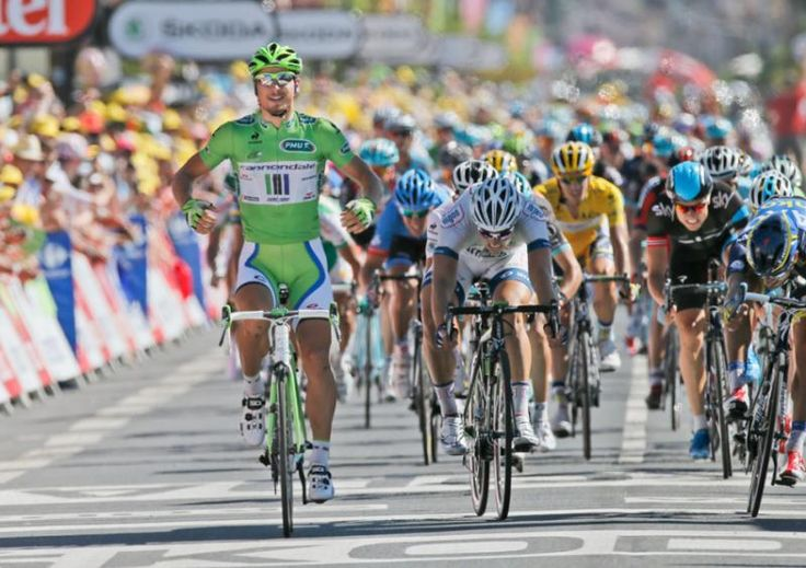 Peter Sagan of Slovakia crosses the finish line ahead of John Degenkolb of Germany, center in white; Daniele Benatti of Italy, right and third place; and Edvald Boasson Hagen of Norway, second right, to win the seventh stage. (Laurent Rebours/AP)