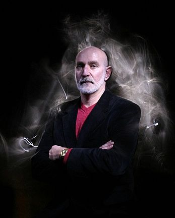 """Paranormal Researcher: John Zaffis trained and worked with his aunt and uncle, Ed and Lorraine Warren. He owns his own museum of haunted/possessed items, and has a SYFY channel T.V. show called, """"Haunted Collector""""."""