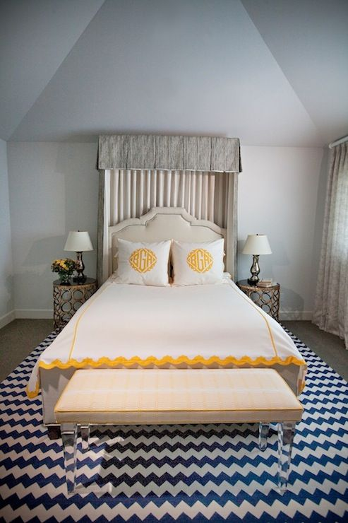 fun blue and yellow bedroom with vaulted ceilings and hardwood floors layered with a large white - Blue And Yellow Bedroom Rugs