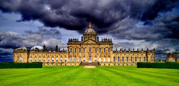 Castle Howard - Although it looks like a castle, Howard is actually a stately home - a private residence of the Howard family that has resided in the complex for more than 300 years. The house, located in North Yorkshire, England, is one of the largest residences in Britain. Its construction commenced at the end of the 17th century