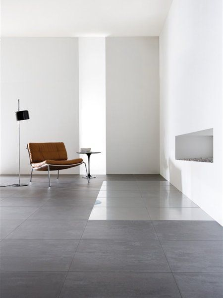concrete floor, leather chair, white walls, modern fireplace