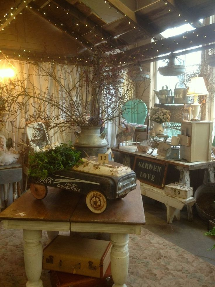 Vintage store display, I'd sure shop more antiques if they would make nice displays like this!  Make the old look new again!