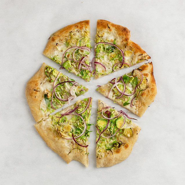 Brussels Sprout-Red Onion Pizza  So glad to find this recipe.  Had a similar pizza at a friend's house but she also added figs.  Did not think I would like it but in fact I loved it!