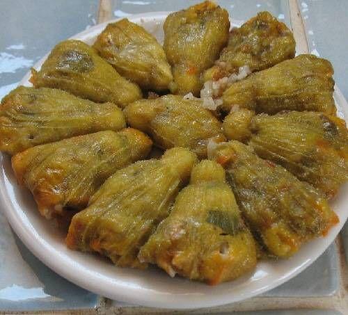 greek traditional vegetarian stuffed squash blossoms. Gemistes kolokithokorfes