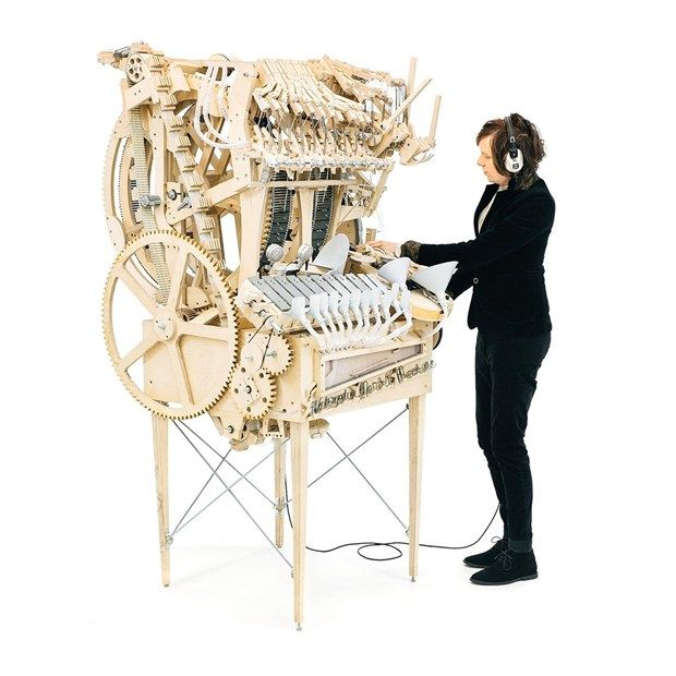 The Wintergartan Marble Machine, built by Swedish musician Martin Molin and filmed by Hannes Knutsson, is a hand-made music box that powers a kick drum, bass, vibraphone and other instruments using a hand crank and 2,000 marbles.