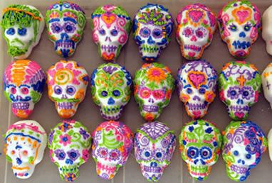 Rows of beautifully decorated sugar skulls from MexicanSugarSkull.com    tons of gorgeous and festive designs.