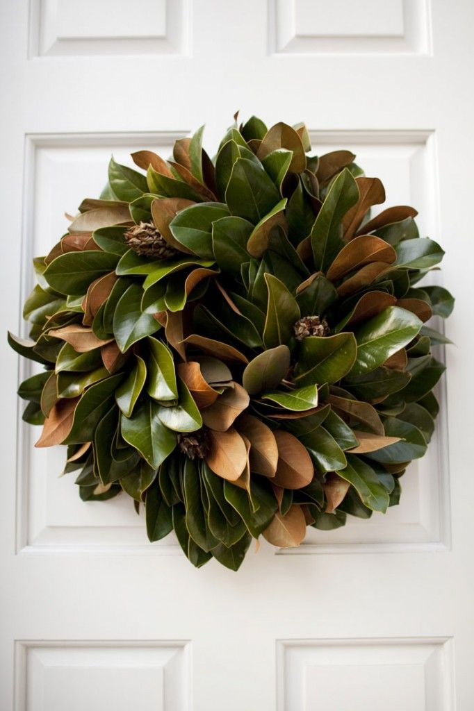 In LOVE with this magnolia leaf wreath...will be making them for the church doors!