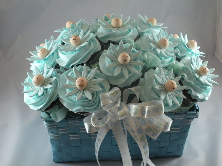 Daisy Baby Shower Cupcake Bouquet - This is similar to another one I made, but this one is for a baby boy.  Gumpaste daisies with  gumpaste/fondant baby faces.
