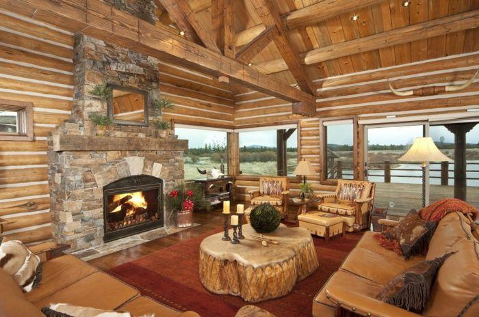 decoracion de salones. chimenea de piedra, mesa de madera rústica, muebles de piel, techo con vigas