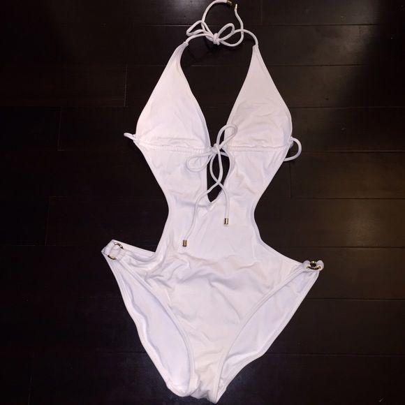 White Victorias Secret Monokini large swimsuit 2014 Victorias Secret White Monokini Swimsuit. Worn once. No stains. No tears. Mint!!!!! Size large. Ties at the front or at the Back. Victoria's Secret Swim One Pieces