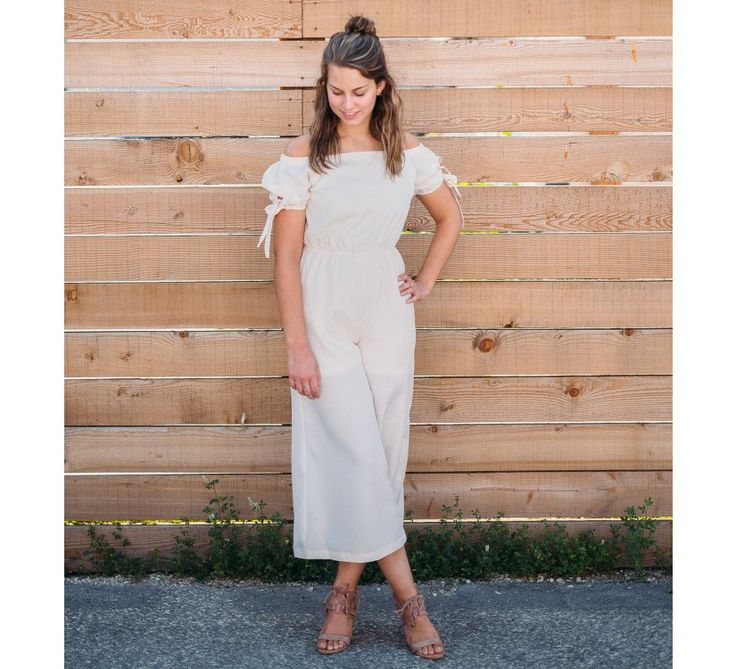 Off the Shoulder Jumpsuit (Cream) - New Arrivals    Slip into comfort for your next event! This jumpsuit features an off the shoulder cut with wide pant legs and tied sleeves. Also available in: Black.