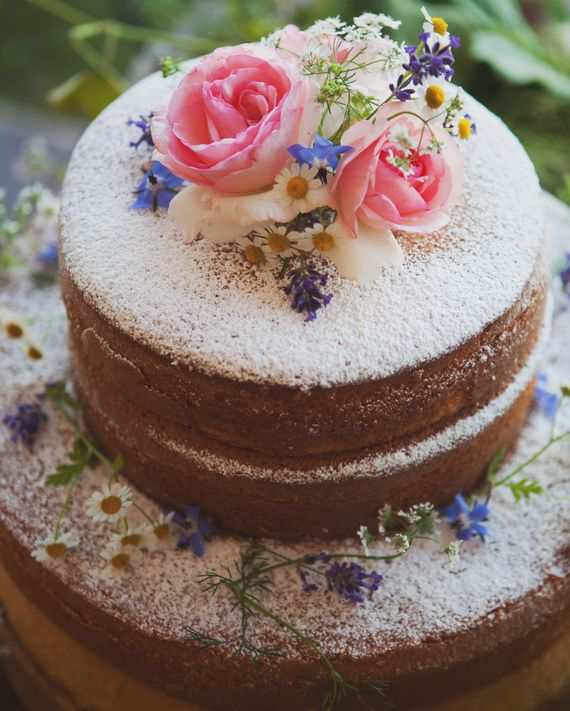 The groom's cousin and his wife, John and Lisa Lofberg, who own Beach Plum Bakery Café in South Dartmouth, gave the couple three cakes as a wedding gift, including this naked almond cake finished with powdered sugar and fresh flowers.