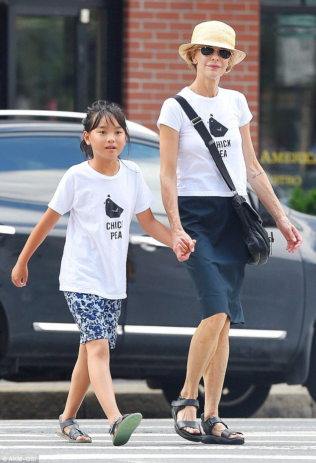 Hand-in-hand: The 52-year-old actress coordinated with her child in matching white T-shirt...
