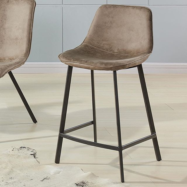 The soft feel of suede - faux suede of course! Easy to clean, looks fabulous and no animals were harmed in the making of the Buren kitchen stool from !nspire. Feel good about your furniture!     http://worldwidehomefurnishingsinc.com/buren-26-counter-stool-in-vintage-brown-2pk.html