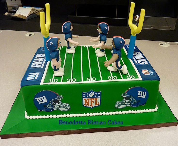 Football field cake design with NY Giants players.