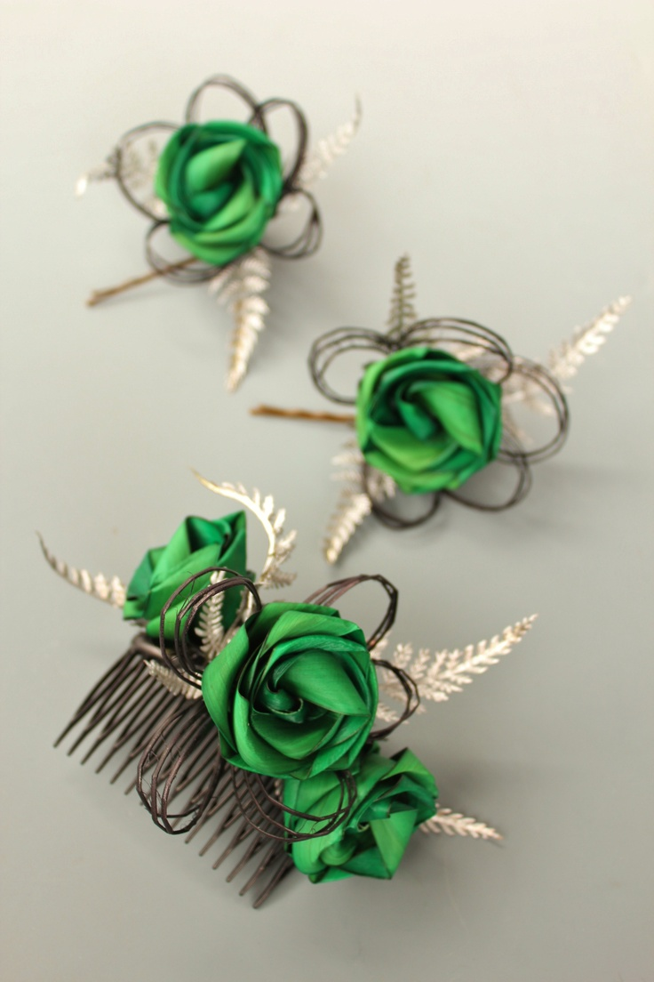 Brides haircomb with bright green flax roses, black loops & silver fern. Bridesmaids single green rose with black loops & silver fern on a bobby pin.  www.flaxation.co.nz