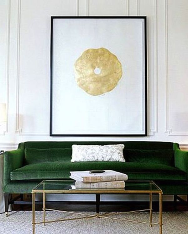 Emerald green couch with gold accents