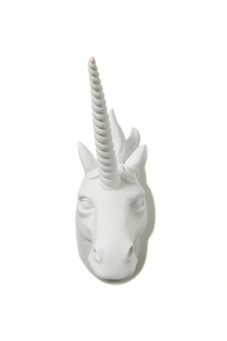 Taxidermy is so last year! Chuck a resin unicorn on your wall and add a little magic to your place! <br> Dimensions: <br> Base height from bottom of neck to top of hair: 24cm <br> Tip of horn to top edge of neck at the base: 27.5cm <br> Width from tip of snout to base: 20.5cm <br/>