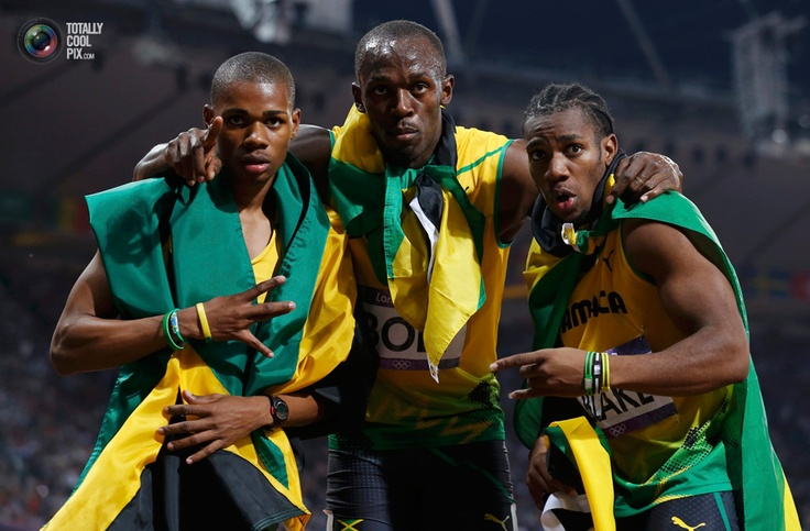 Day 13 - Third placed Warren Weir of Jamaica and compatriots first placed Usain Bolt and second placed Yohan Blake pose after the men's 200m final during the London 2012 Olympic Games . STEFANO RELLANDINI/REUTERS