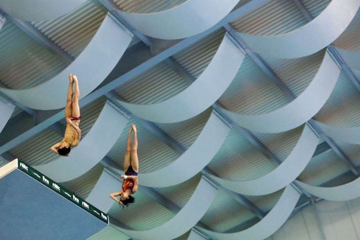 Windsor, Ontario, Canada Jie Lian (R) and Xiaohu Tai (L) of China competes in the Mixed 10m Synchro Final during the FINA/NVC Diving World Series at the Windsor International Aquatic & Training Centre on May 24.