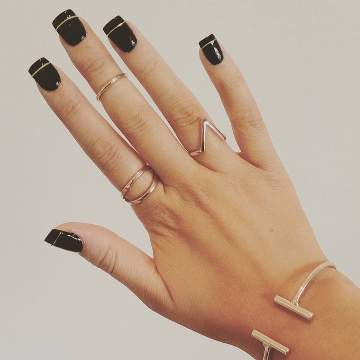 Black and gold acrylic nails. Love them