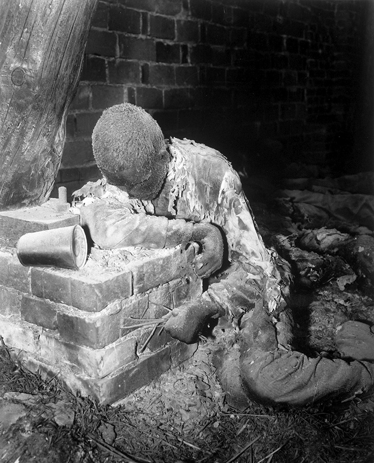 Horrible. This victim of Nazi inhumanity still rests in the position in which he died, attempting to rise and escape his horrible death. He was one of 150 prisoners savagely burned to death by Nazi SS troops. Gardelegen, Germany. April 16, 1945. Sgt. E. R. Allen. (Army)