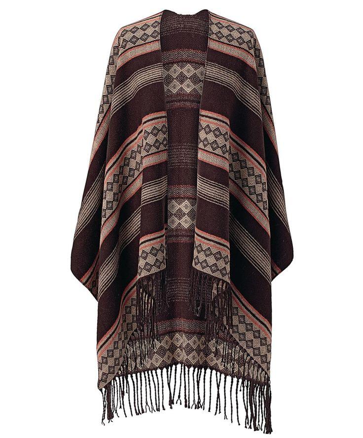 Gemusterter Strickponcho im Ethno-Stil mit Fransenkante. Schön zu Country-Outfits in gedeckten Farben.
