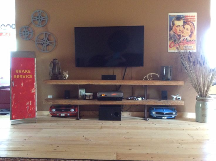 Old bridge beams repurposed into an entertainment stand.