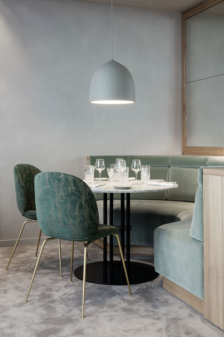 GUBI's Beetle Chairs are used throughout the space in various textiles that represent a Nordic approach with Art Deco influences.