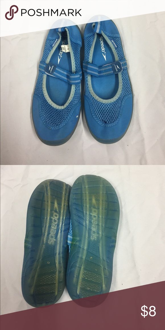 Speedo Water Shoes. Turquoise and White with Velcro strap across the foot. Sign of wear on shoes with Gel bottoms. Speedo Shoes