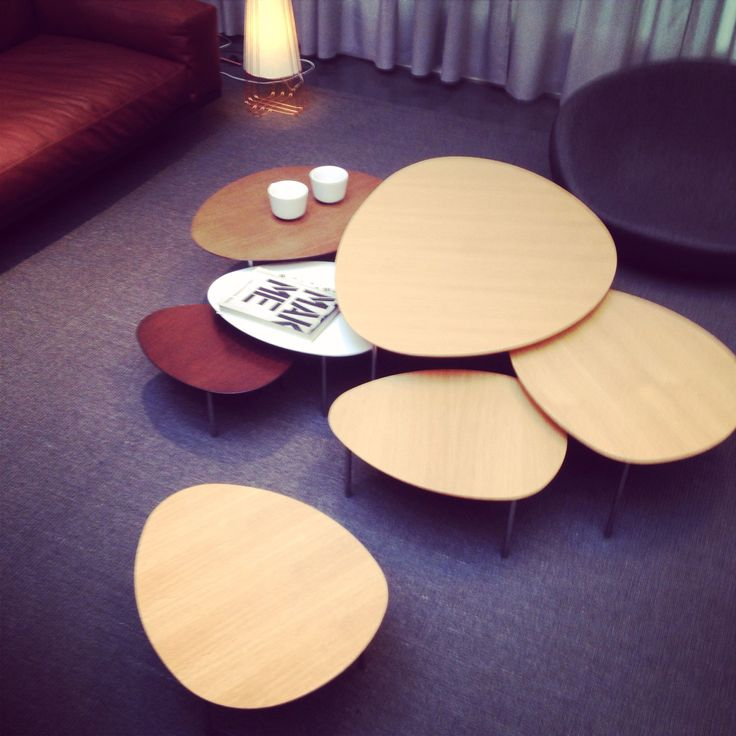 A diverse group of STUA Eclipse nesting tables as displayed in Domésticoshop in…