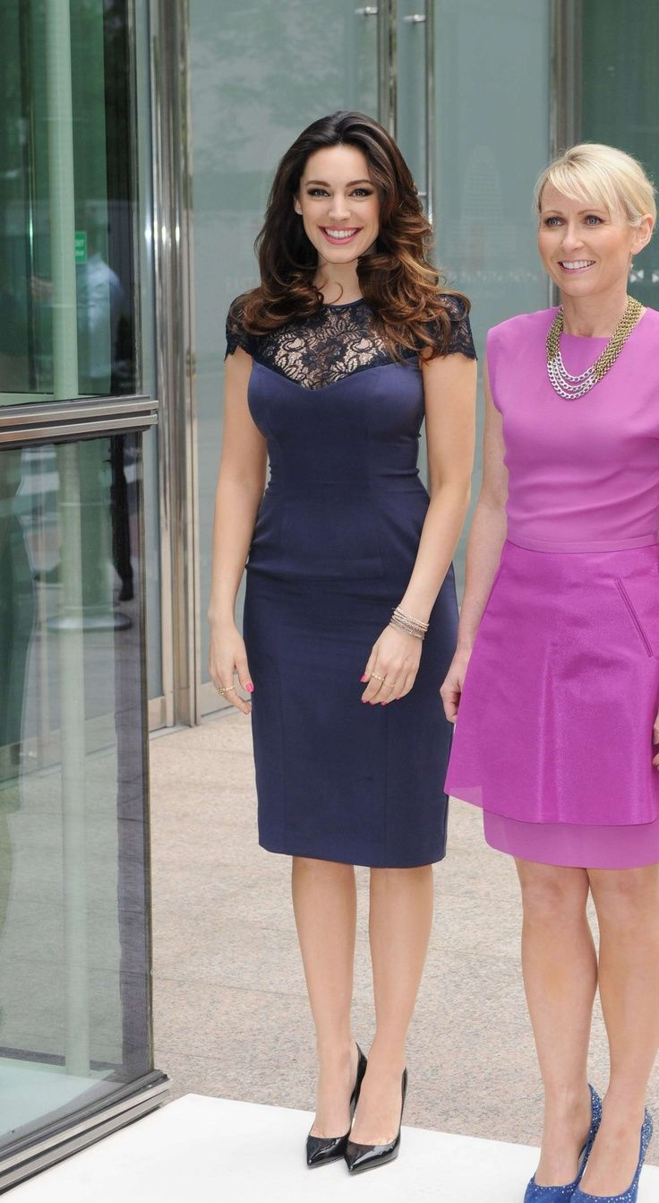 Love the navy dress... Kelly Brook at Lorraine High Street Fashion Awards in London, May 2013.