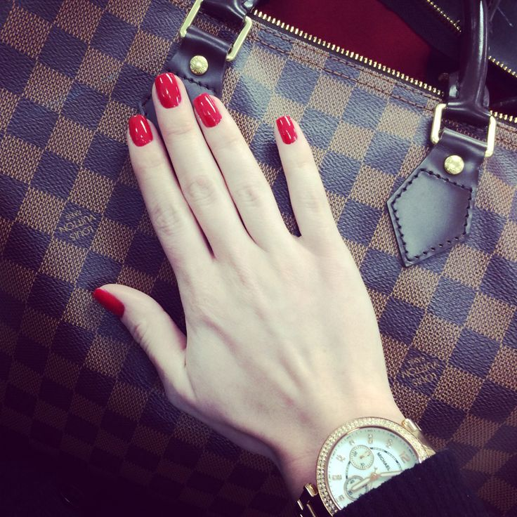 Nails done with OPI thrill of Brazil manicure and speedy 35 Louis Vuitton