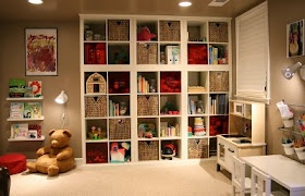 This site is full of descriptions of how people have used stock IKEA pieces plus a trip to the local hardware store to create inexpensive custom storage solutions.