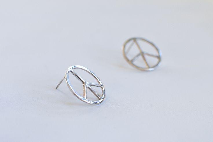 Peace on Earth silver earrings. Details: Sterling silver, handmade in Stockholm, 20 x 20 mm
