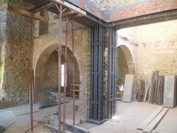 Here is another renovation shot - beautiful Tuscan arches!